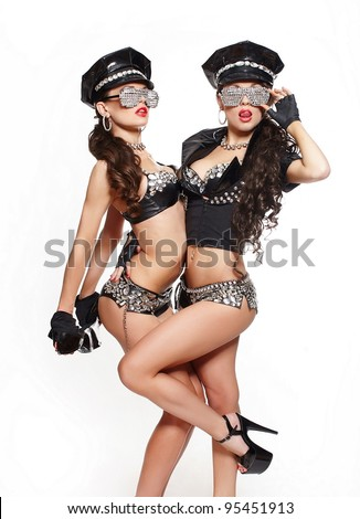 two sexy beautiful  brunette semi nude police women with long curly hair with handcuffs in fashion glasses with bright makeup and red lips isolated on white - stock photo
