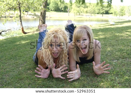 Two Sexy Blond Mature Women Playing in the Park - stock photo