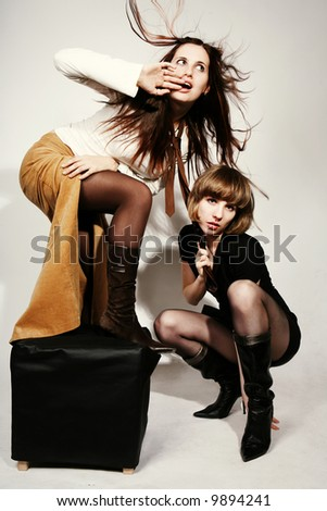 Two sexy girls in the wind - stock photo