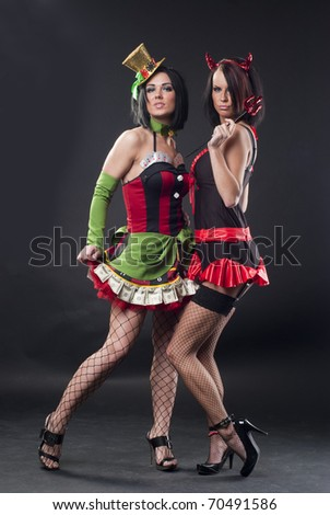 Two sexy ladies in costumes - stock photo