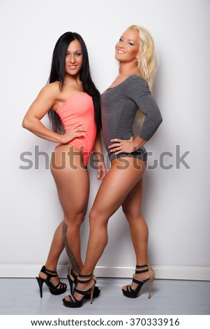Two sexy ladys in underwear. Couple. Blond and brunette women. - stock photo