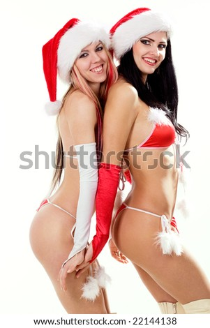 Two sexy playful girls in red bikini and christmas hats