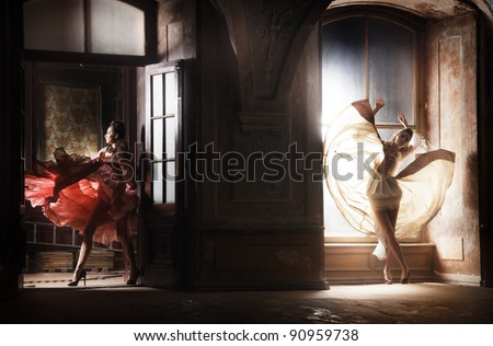 Two sexy woman in gorgeous dresses - stock photo