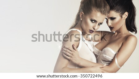 Two sexy woman in lingerie  - stock photo
