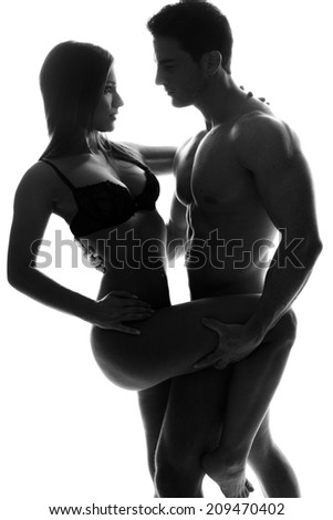 Two Sexy Young Couple Sensually Pose. Emphasizing Perfect body on White Background. - stock photo
