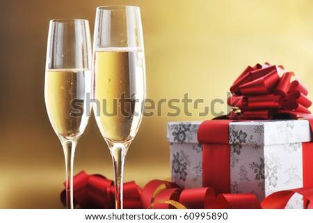 two shampagne glasses on celebratory table - stock photo