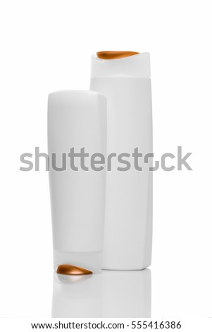 Two Shampoo bottles on white background. Orange and white bottles.