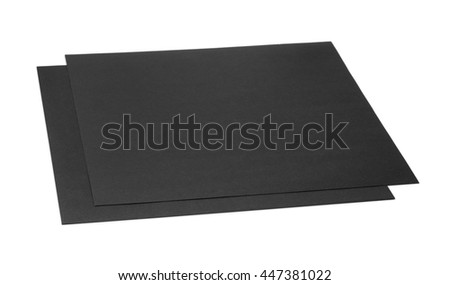 Two sheets of black craft cardboard isolated on white - stock photo