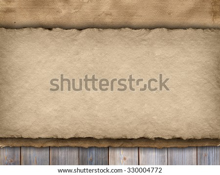 Two sheets of handmade paper on wooden wall background