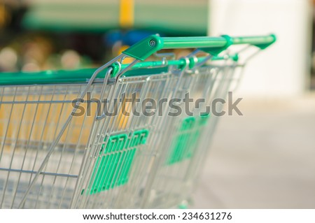Two shopping cart on parking lot near supermarket - stock photo