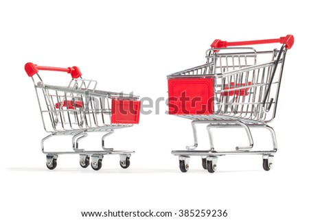 Two shopping carts, isolated on white background.