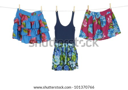 Two Short flower skirt and sundress on a clothespins on rope