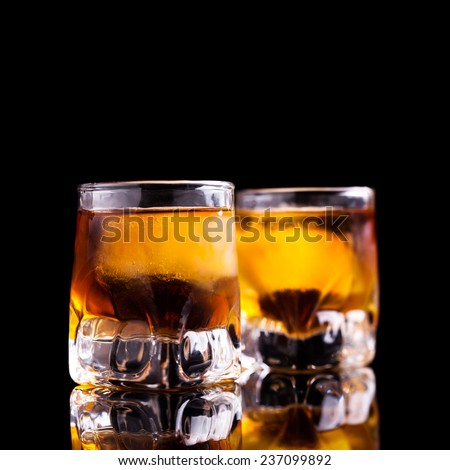 two shots of rum - stock photo