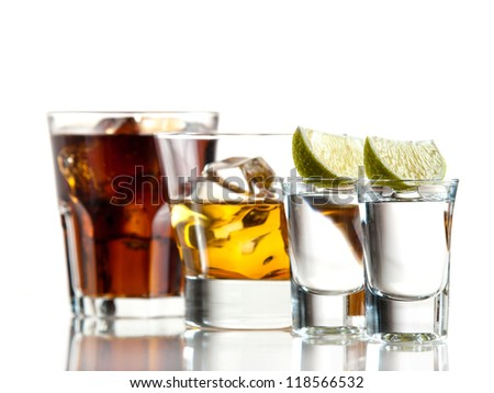 Two shots of tequila, whiskey on the rocks, cuba libre - stock photo