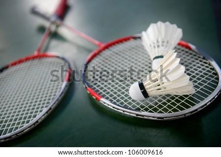 two shuttlecocks and badminton racket. - stock photo
