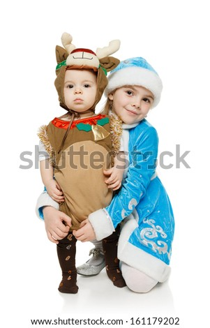 Two siblings in Xmas costumes over white background - stock photo