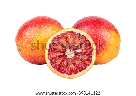 Two Sicilian orange fruit with a juicy half on a white background
