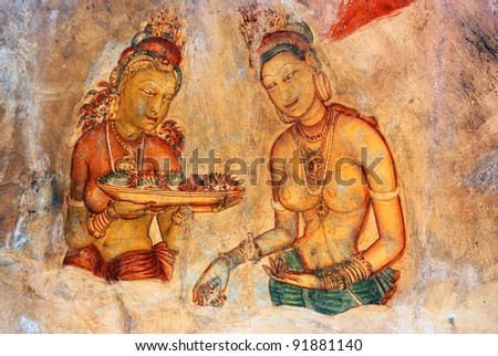 Two Sigiriya maiden with fruits: one of the 5th century frescoes at the ancient rock fortress of Sigiriya, a UNESCO World Heritage Site in Sri Lanka - stock photo