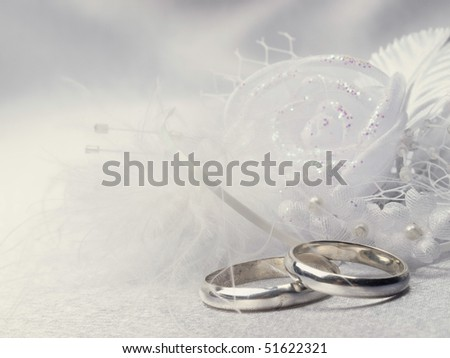 Two silver weddings rings and floral  decoration - stock photo