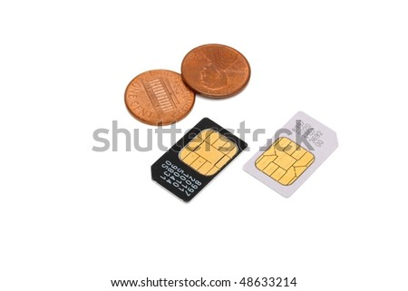 Two SIM cards for cellular phones and Americal cents isolated - stock photo