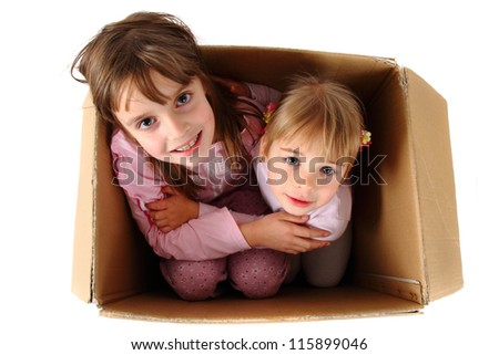 two sister in the paper box isolated on the white background - stock photo