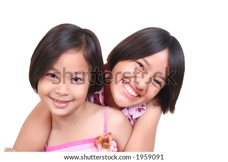 Two sisters having a good time. - stock photo