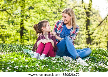 Two sisters having fun in park