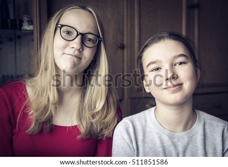 Two sisters in their room.  Selective focus