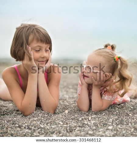 Two sisters looking at each other with love - stock photo