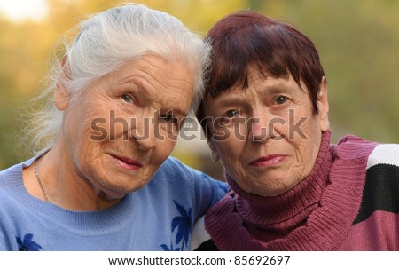 Two sisters of old age. A photo on outdoors - stock photo