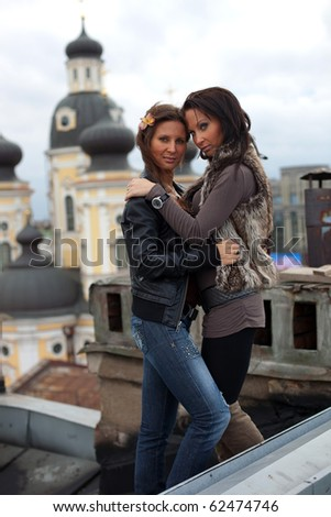 Two sisters on the roof - stock photo