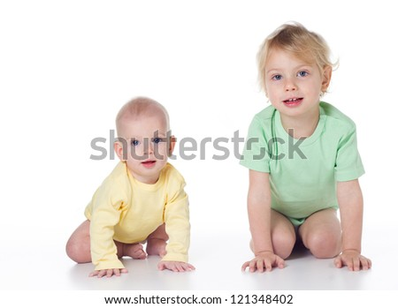 two sisters sitting side by side on a white background