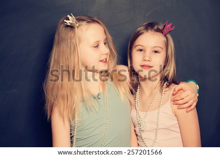 Two sisters smiling, portrait - stock photo