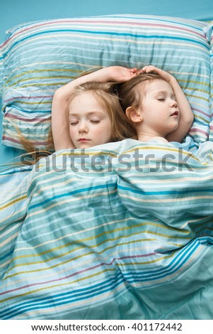 Two sisters sweet sleep holding hands
