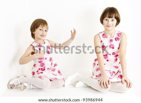 two sisters wearing similar dresses - stock photo