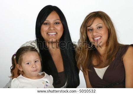 Two sisters with a toddler girl