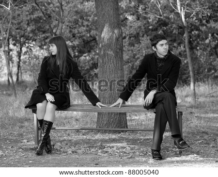 Two sitting at bench. Photo in old image style. - stock photo