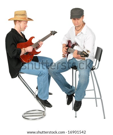 Two sitting men in hats  play on guitars