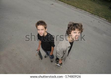two skate boarders - top view perspective - stock photo
