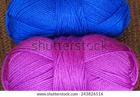 Two skeins of blue and magenta knitting yarn - stock photo