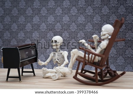 Two skeletons listening to radio