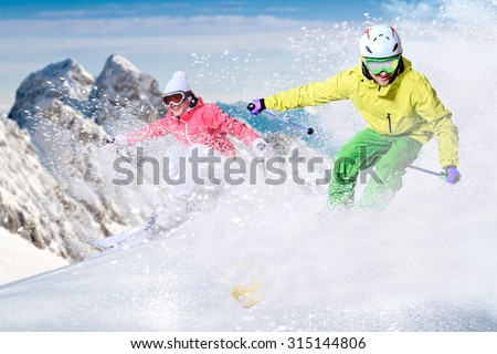 Two ski driver on the piste in Alps - stock photo
