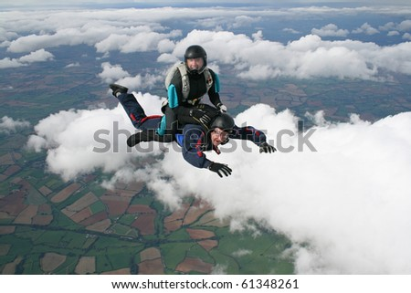 Two skydivers in freefall - stock photo