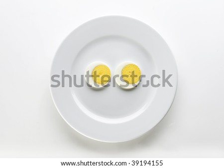 Two slices of boiled egg - stock photo