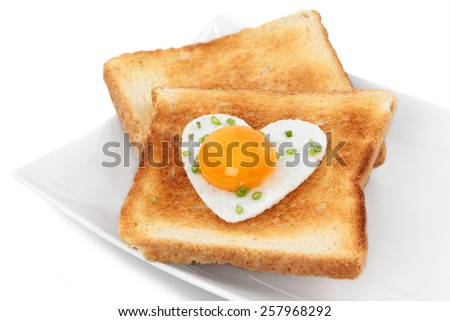 Two slices of breakfast sandwich with egg on a plate - stock photo