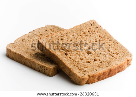 two slices of brown bread on white background - stock photo