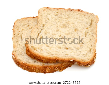 two slices of oat bread on white background  - stock photo