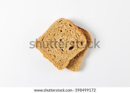 two slices of whole grain bread - stock photo