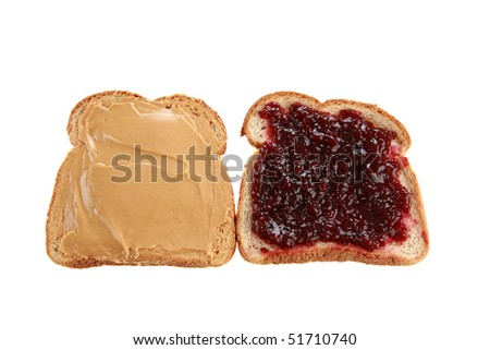 two slices of whole wheat bread with peanut butter and raspberry jelly isolated on white - stock photo