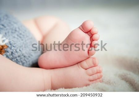 Two small baby leg  - stock photo